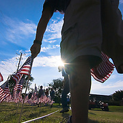 08/29/11 Bear DE: Volunteer Tom Campbell install one of 6,194 flags that represents every soldier that died in the war on terror including three soldier that died in Afghanistan on Aug. 29, 2011. ..The flags will be seen on the front lawn of Glasgow Reformed Presbyterian Church...The News Journal/SAQUAN STIMPSON