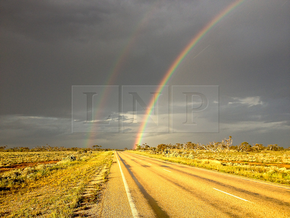 © Licensed to London News Pictures. 14/09/2013. Nullarbor, Western Australia, Australia. A double rainbow heralds some showery weather ahead in this remote part of Western Australia.. James Ketchell world cycle/ global triathlon. The previous parts of this incredible and unique series were an Atlantic solo row in 2010 and summiting Everest in 2011.Photo credit : James Ketchell/LNP