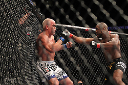 August 6, 2011; Philadelphia, PA; USA; Rashad Evans (black trunks) and Tito Ortiz (white trunks) during their UFC light heavyweight bout at UFC 133 at the Wells Fargo Center.