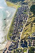 Nederland, Friesland, Vlieland, 28-02-2016; Oost-Vlieland met Dorpsstraat, links Waddendijk. Posthuiswad.<br /> Wadden island Vlieland and Oost-Vlieland village, Wadden sea. <br /> luchtfoto (toeslag op standard tarieven);<br /> aerial photo (additional fee required);<br /> copyright foto/photo Siebe Swart