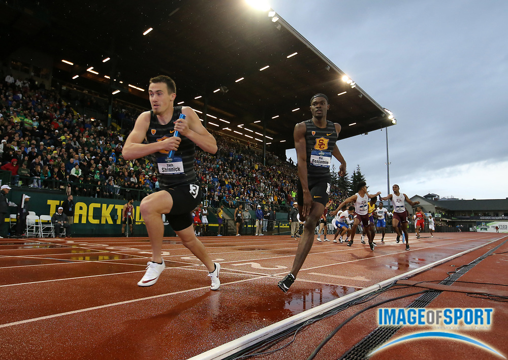 Jun 8, 2018; Eugene, OR, USA; Zach Shinnick takes the handoff from Rai Benjamin on the third leg of the Southern California Trojans 4 x 400m relay that won in a collegiate record 2:59.00 during the NCAA Track and Field championships at Hayward Field.