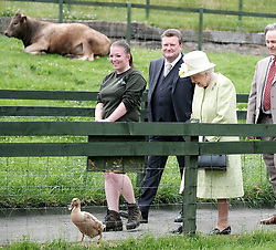 The Queen visited Gorgie City Farm in Edinburgh today as part of Royal Week.<br /> <br /> Gorgie City Farm is a community based initiative first opened in 1982<br /> <br /> Pictured: The Queen is shown around the inner city farm and follows Olive The Duck towards the cafe<br /> <br /> Alex Todd | Edinburgh Elite media