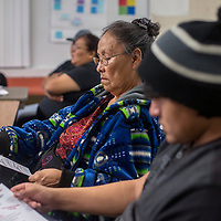 Priscilla Billsie, middle, sits with her son, Travis Begaye, right, learn about the admission process for University of New Mexico during the parent's night Thursday at Gallup Central high school in Gallup.