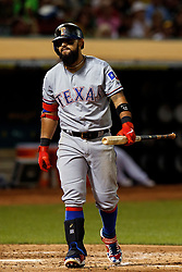 OAKLAND, CA - SEPTEMBER 21:  Rougned Odor #12 of the Texas Rangers returns to the dugout after striking out against the Oakland Athletics during the fourth inning at the RingCentral Coliseum on September 21, 2019 in Oakland, California. The Oakland Athletics defeated the Texas Rangers 12-3. (Photo by Jason O. Watson/Getty Images) *** Local Caption *** Rougned Odor
