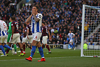 Football - 2018 / 2019 Premier League - Brighton and Hove Albion vs. Newcastle United<br /> <br /> Shane Duffy of Brighton holds his head in his hands after narrowly heading over from close range during the Premier League match at The Amex Stadium Brighton  <br /> <br /> COLORSPORT/SHAUN BOGGUST
