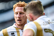 Milton Keynes Dons defender Dean Lewington (3) has a word with Milton Keynes Dons midfielder (on loan from Chelsea) Jordan Houghton (24) during the EFL Sky Bet League 2 match between Milton Keynes Dons and Mansfield Town at stadium:mk, Milton Keynes, England on 4 May 2019.