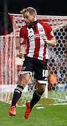 Brentford midfielder Alan Judge celebrates his second goal of the game during the Sky Bet Championship match between Brentford and Rotherham United at Griffin Park, London, England on 17 October 2015. Photo by Andy Walter.