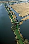 Nederland, Zuid-Holland, Kinderdijk, 08-03-2002; historische (water) windmolens gebruikt voor het uitslaan van het boezemwater uit de polders vd Alblasserwaard; toerisme bezienswaardigheid  Nederland waterland waterbeheer infrastructuur windenergie geschiedenis. molens.<br /> luchtfoto (toeslag), aerial photo (additional fee)<br /> foto /photo Siebe Swart