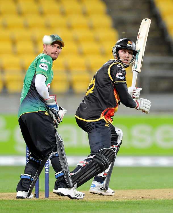 Wellington Firebirds Stephen Murdoch, right, nicks the ball past wicket keeper Central Stags Kruger van Wyk in the HRV T20 cricket match at Westpac Stadium, Wellington, New Zealand, Friday, November 22, 2013. Credit:SNPA / Ross Setford