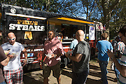 As the voting deadline approaches, men try the last of Phil's cheesesteaks. At this truck, men vastly outnumbered women tasters.