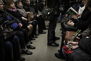 A young couple heading to Maidan hold carnations in the Kiev's subway. Carnations are laid at Maidan square memorials to honour the anti-government protesters who were killed by police snipers during clashes on February 20th. Kiev, 26 February 2014.