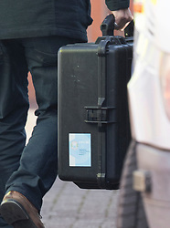 © Licensed to London News Pictures. 21/03/2018. Salisbury, UK. A man carries a case bearing a sticker of the Investigators from the Organisation for the Prohibition of Chemical Weapons (OPCW) as they arrive at The Mill pub in Salisbury as police continue their investigation after former Russian spy Sergei Skripal was taken after he and his daughter Yulia were poisoned with nerve agent. The couple where found unconscious on bench in Salisbury shopping centre. A policeman who went to their aid is currently recovering in hospital. Photo credit: Peter Macdiarmid/LNP