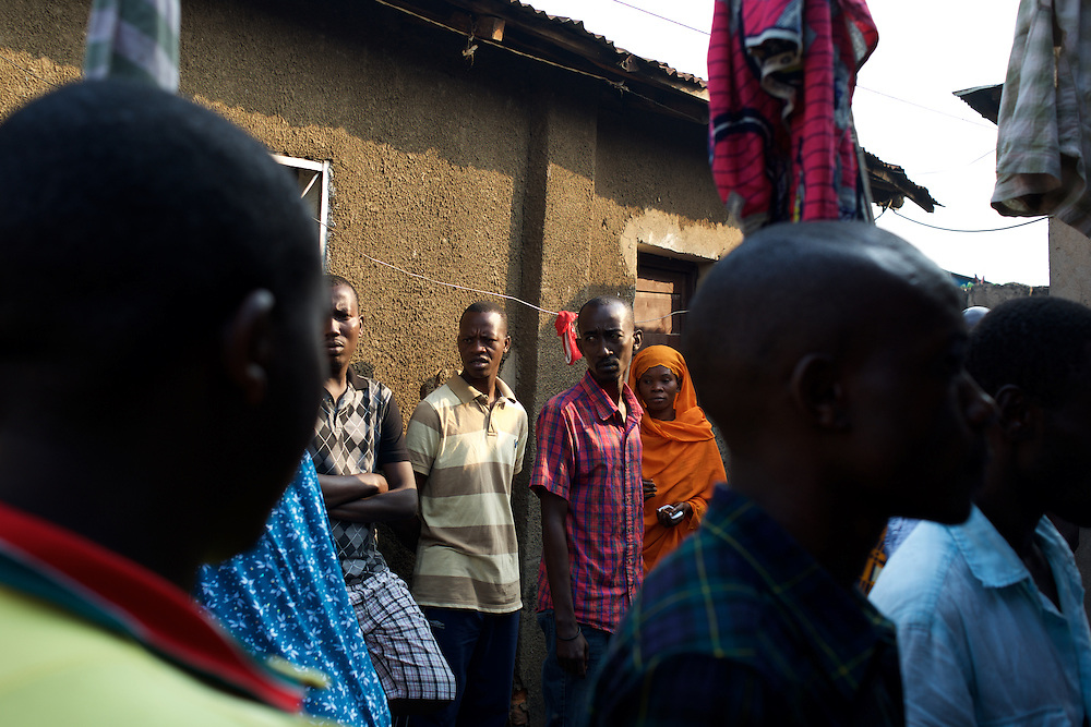Local people stand at the yard of Abdul Masumbuko's house, a young man allegedly killed by a grenade he was handling in Jade neighbourhood in Bujumbura, June 28, 2005.