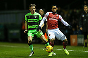 Forest Green Rovers Theo Archibald(18) and Arsenal's Trae Coyle(70) during the EFL Trophy group stage match between Forest Green Rovers and U21 Arsenal at the New Lawn, Forest Green, United Kingdom on 7 November 2018.