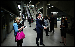 The Prime Minister waiting on the platform at a Tube station to catch a Tube back to Westminster, London, Thursday October 6, 2011. Photo By Andrew Parsons / i-Images.