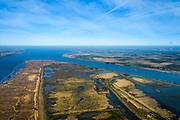 "Nederland, Zuid-Holland, Tiengemeten, 01-04-2016;  Het eiland Tiengemeten (abusieveelijke ook  Tiengemeenten) werd oorspronkelijk gebruikt voor de akkerbouw maar is inmiddels 'teruggegeven aan de natuur': de dijken zijn deels doorgestoken en de laatste boer is in 2006 vertrokken. De 'nieuwe natuur' vormt onderdeel van de Ecologische Hoofdstructuur.<br /> The island Tiengemeten in the Haringvliet, was originally used for agriculture but has now ""been given back to nature"". Large parts have been flooded and the isle is part of the National Ecological Network. The last farmer left in 2006. Current use, among other, care farms and camping. luchtfoto (toeslag op standard tarieven);<br /> aerial photo (additional fee required);<br /> copyright foto/photo Siebe Swart"