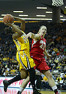 January 08 2010: Iowa guard Kachine Alexander (21) puts up a shot as Ohio St. forward Sarah Schulze (43) defends during the first half of an NCAA womens college basketball game at Carver-Hawkeye Arena in Iowa City, Iowa on January 08, 2010. Iowa defeated Ohio State 89-76.