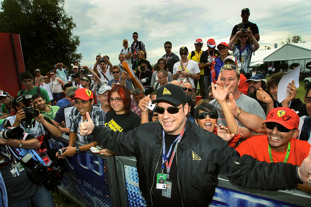 Australian Formula One Grand Prix, Actor John Travolta with fans 27/03/2010 Pic By Craig Sillitoe SPECIAL 000 This photograph can be used for non commercial uses with attribution. Credit: Craig Sillitoe Photography / http://www.csillitoe.com<br /> <br /> It is protected under the Creative Commons Attribution-NonCommercial-ShareAlike 4.0 International License. To view a copy of this license, visit http://creativecommons.org/licenses/by-nc-sa/4.0/.