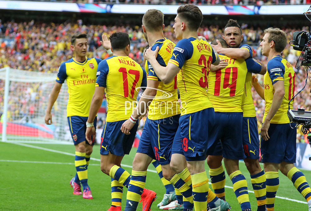 Arsenal players congratulate Arsenal's Theo Walcott after his goal during the The FA Cup match between Arsenal and Aston Villa at Wembley Stadium, London, England on 30 May 2015. Photo by Phil Duncan.
