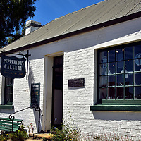 Mill Cottage in Richmond, Australia <br /> Mill Cottage has housed a long list of entrepreneurs since it was built in 1850. This includes a bootmaker, seamstress, piano school and tea room. In 1983, it reopened as Peppercorn Galley. They represent a dozen local artists by marketing their paintings, ceramics, woodcarvings, jewelry and handicrafts. It is one lovely example of why Richmond is such a popular attraction for international tourists and local Aussies. Visitors sense they are experiencing a British colonial village which is suspended in time.