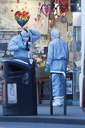 © Licensed to London News Pictures. 03/02/2020. London, UK. Scenes of crime officers gather evidence on Streatham High Road the day after a man was shot by police after he stabbed two people. Sudesh Amman, who was released from prison recently for terror offences, was under active police surveillance at the time of the attack - which police think was an Islamist-related terrorist incident. Photo credit: Peter Macdiarmid/LNP