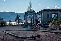 LAKE COUNTRY, CANADA - JULY 16: The charred remains of a home on Nighthawk stand in the aftermath of the Okanagan Centre fire on July 16, 2017 in Lake Country, British Columbia, Canada.  (Photo by Marissa Baecker/Shoot the Breeze)  *** Local Caption ***