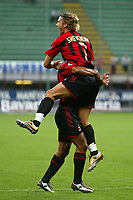 Milano 21/8/2004 Supercoppa Italiana - Italian Supercup Milan Lazio 3-0 Andriy Shevchenko esulta al gol del vantaggio del Milan con Marcos Cafu. Andriy Shevchenko celebrates first goal for Milan with his teammates Marcos Cafu. <br /> <br /> Foto Andrea Staccioli Graffiti