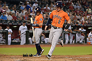 PHOENIX, AZ - AUGUST 15:  Alex Bregman #2 of the Houston Astros scores on a wild pitch in front of teammate Jose Altuve #27 in the second inning against the Arizona Diamondbacks at Chase Field on August 15, 2017 in Phoenix, Arizona.  (Photo by Jennifer Stewart/Getty Images)