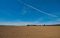 Chartres, France. Flat, rural landscape with farm buildings in the distance.