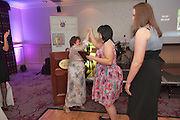 Special Achievement Winner, Linda O?Connell, Ballybane high fives with Linda Keane at the Ability West, Best Buddies ball at the Menlo Park Hotel, Galway. Photo:Andrew Downes Photography.