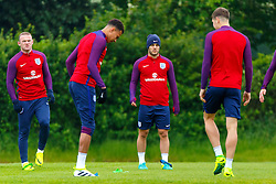 © Licensed to London News Pictures. 01/06/2016. London, UK. England's WAYNE ROONEY and JACK WILSHERE train with England team at Watford Training Ground on Wednesday, 1 June 2016, ahead of the Euro 2016 in France. Photo credit: Tolga Akmen/LNP