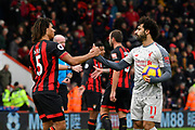 Nathan Ake (5) of AFC Bournemouth congratulates hatrick hero Mohamed Salah (11) of Liverpool at full time after a 4-0 win over Bournemouth during the Premier League match between Bournemouth and Liverpool at the Vitality Stadium, Bournemouth, England on 8 December 2018.