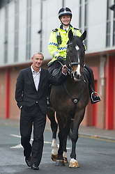 LIVERPOOL, ENGLAND - Monday, April 4, 2011: Liverpool's legendary number nine Ian Rush pictured walking along Anfield Road with Jaguar the Merseyside Police Horse Number Nine ridden by Sergeant Sarah Hamilton. Jaguar will be leading the winning horse to the winner's circle on Saturday at the John Smith's Aintree Grand National. (Photo by David Rawcliffe/Propaganda)