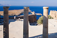 Columns and view of the sea from The Acropolis, Lindos, Rhodes, Dodecanese Islands Greece
