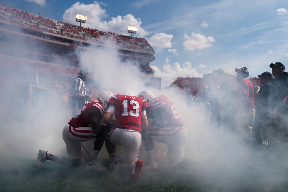 Nebraska captains kneel prior to Nebraska's game vs. Rutgers at Memorial Stadium in Lincoln, Neb., on Sept. 23, 2017. Photo by Aaron Babcock, Hail Varsity