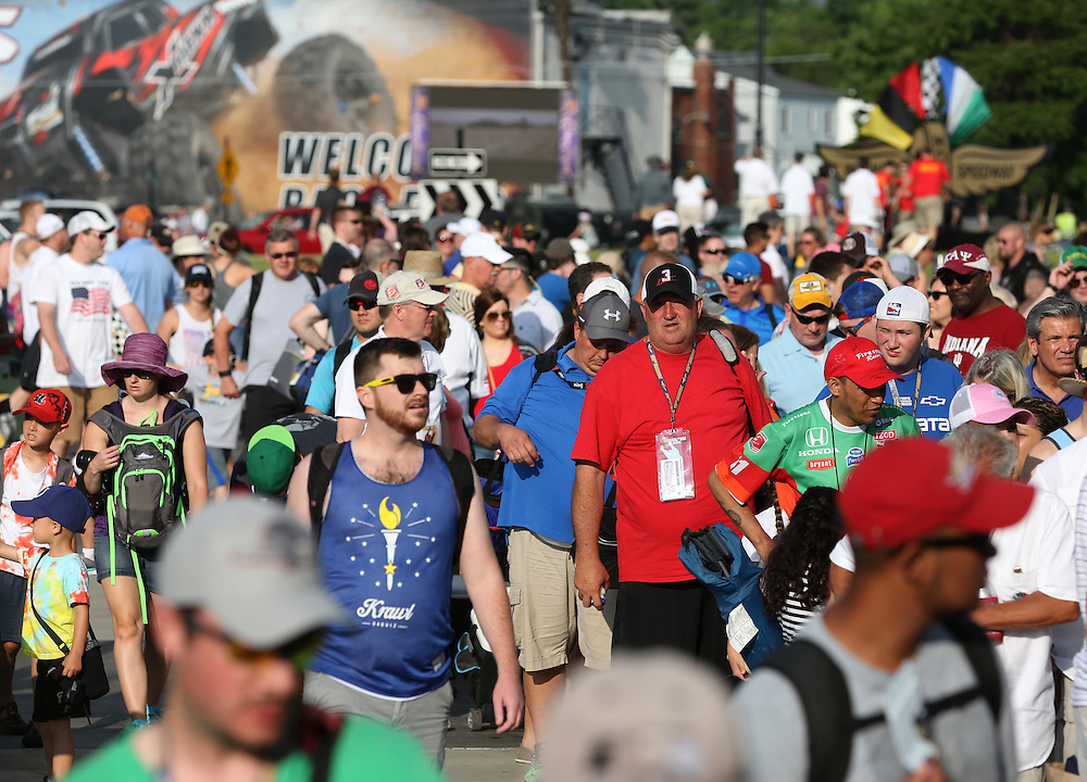 People enter the track before the 100th running of the Indianapolis 500 May 29, 2016.