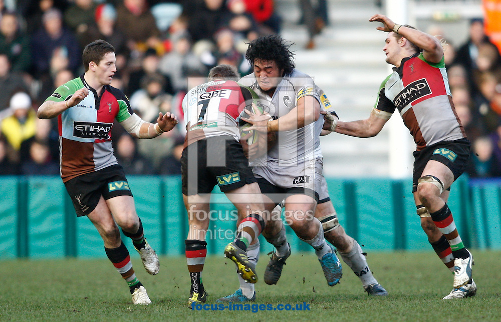 Picture by Andrew Tobin/Focus Images Ltd. 07710 761829.. 28/01/12. Logovii Mulipola (C) of Leicester is tackled by Will Skinner (7) of Harlequins during the The LV= Cup match between Harlequins and Leicester at the Twickenham Stoop stadium, London