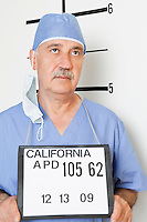 Mug shot of senior male surgeon