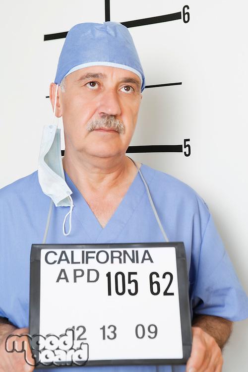 Mug shot of senior male surgeon