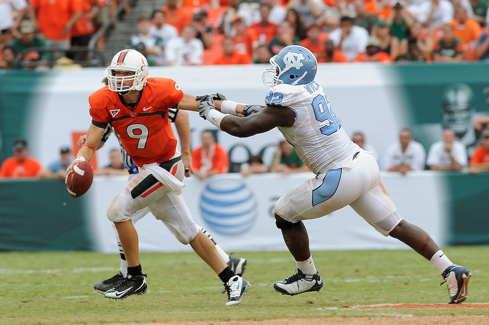 Sepember 28, 2008 - Miami Gardens, FL<br /> <br /> University of Miami quarterback Robert Marve is chased by University of North Carolina defensive lineman E.J. Wilson during the Tar Heels 28-24 victory over the Hurricanes at Dolphin Stadium in Miami Gardens, Florida.<br /> <br /> JC Ridley/CSM
