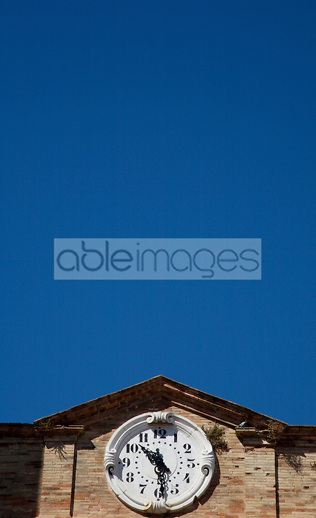 Clock tower against cloudless blue sky