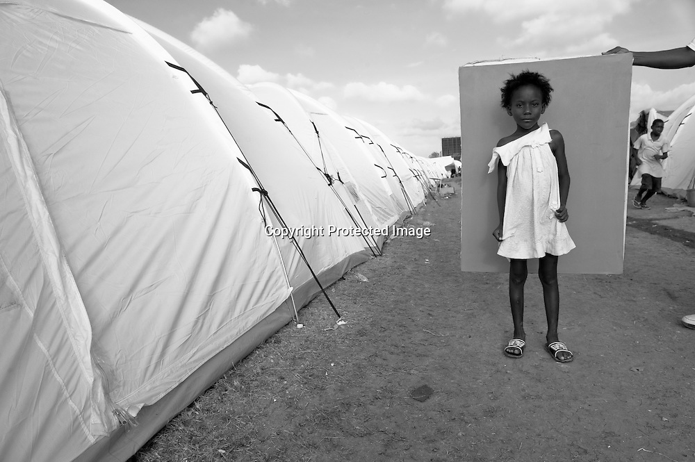 Telemack Rosemane, age 6, lives in a tent camp with eight members of her family near the Port-au-Prince airport. When the earthquake hit, her mother scooped Telemack and her siblings into her arms, falling down once and then regaining her footing to flee their house in the Cite Soleil neighborhood before it crashed down behind them.