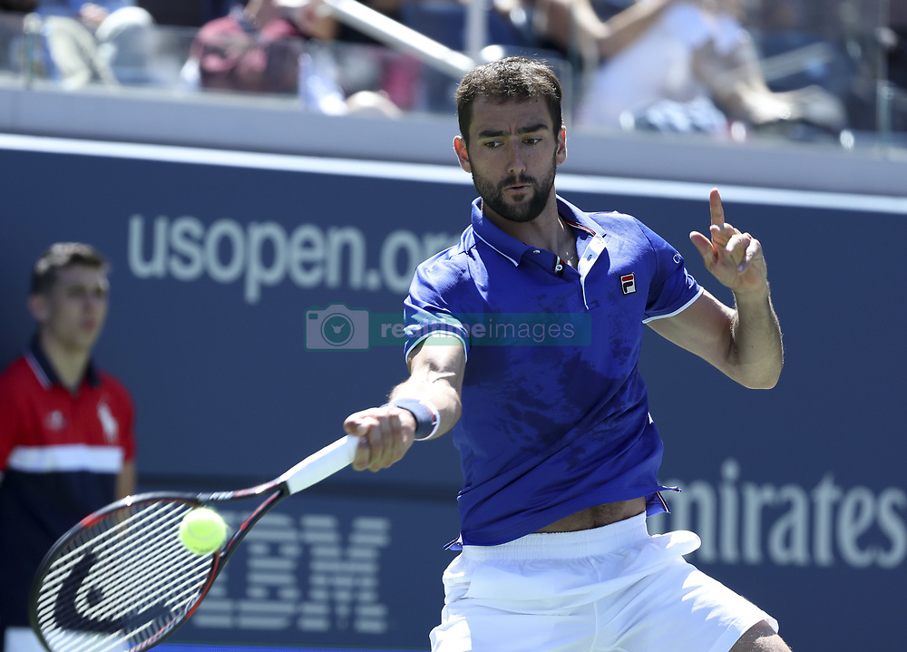 NEW YORK, Sept. 2, 2017  Marin Cilic of Croatia hits a return during the men's singles third round match against Diego Schwartzman of Argentina at the 2017 US Open in New York, the United States, Sept. 1, 2017. Diego Schwartzman won 3-1. (Credit Image: © Wang Ying/Xinhua via ZUMA Wire)