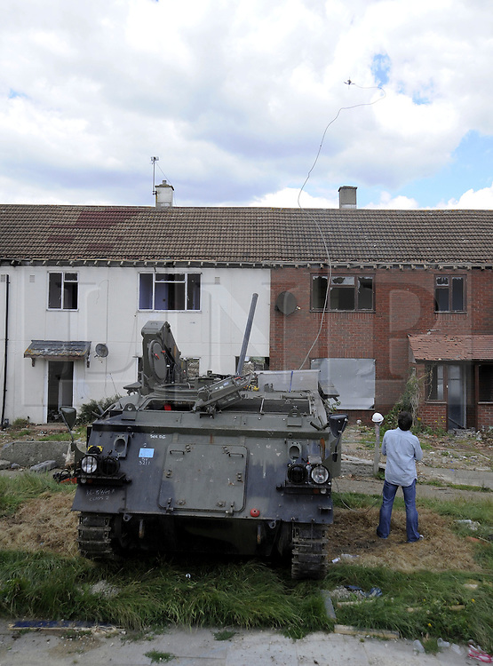 ©  licensed to London News Pictures. 01/07/2011. Gravesend, Kent. Richard Hammond  firing his Tank Harpoon over houses. Richard Hammond using a harpoon to damage the roof of a house. Top Gear presenters Jeremy Clarkson, James May and Richard Hammond smashing up old houses in Gravesend, Kent with tanks during filming for Top Gear today (01/07/2011). See special instructions. Photo credit Grant Falvey/LNP.