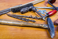05 April 2014:   Antique tools include hammer, brace, bit, drill, chisel, washers, wing nuts, bolt, screwdriver rasp, keyhole saw, file