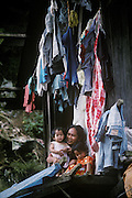 Mount Diwata, Mindanao, The Philippines. Life in the goldrush town that sprung up with over 70 tunnelers drawn to the mountain in search of fortune.
