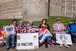 © Licensed to London News Pictures. 20/04/2016. Windsor, UK. (L to R) Kathy Martin, John Loughrey, Maria Scott, Amy Thompson and Terry Hutt are royal fans who will camp out overnight in order to be in prime position in order to see The Queen as she takes part in a walkabout outside Windsor Castle tomorrow her 90th birthday tomorrow. Photo credit : Stephen Chung/LNP
