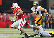 November 25, 2011: Iowa Hawkeyes linebacker Christian Kirksey (20) can't stop Nebraska Cornhuskers running back Rex Burkhead (22) on a run during the second half of the NCAA football game between the Iowa Hawkeyes and the Nebraska Cornhuskers at Memorial Stadium in Lincoln, Nebraska on Friday, November 25, 2011. Nebraska defeated Iowa 20-7.