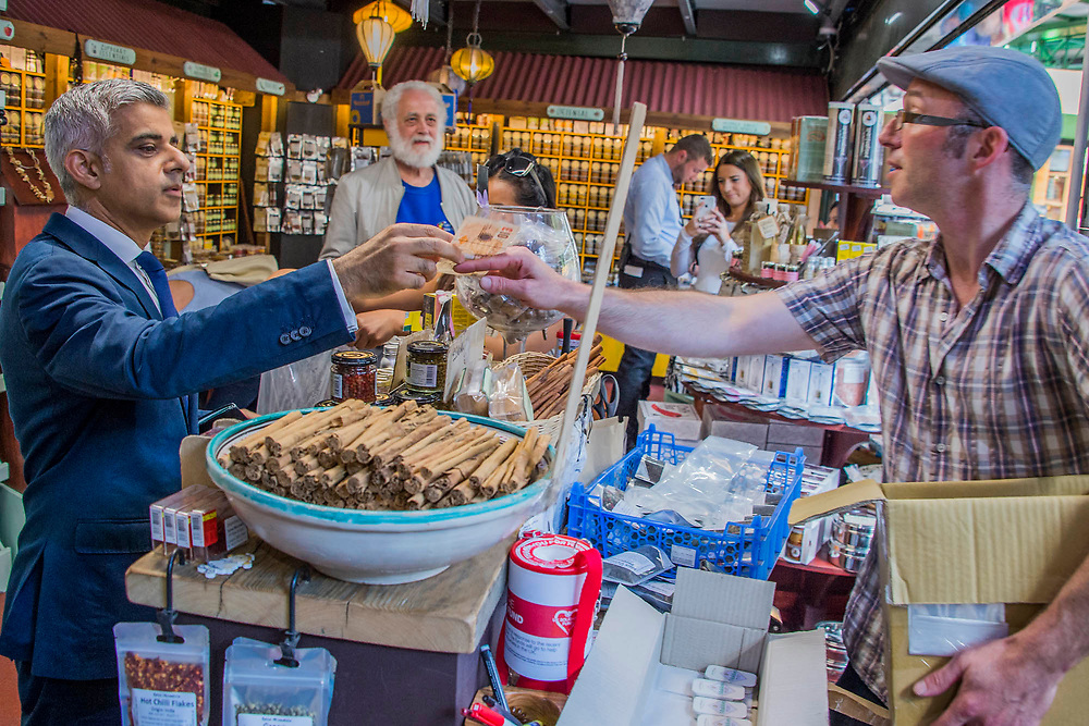 The Mayor Sadiq Khan meets stall holders and buys a box of spices from the Spice Mountain - The market reopening is signified by the ringing of the bell and is attended by Mayor Sadiq Khan. Tourists and locals soon flood back to bring the area back to life.