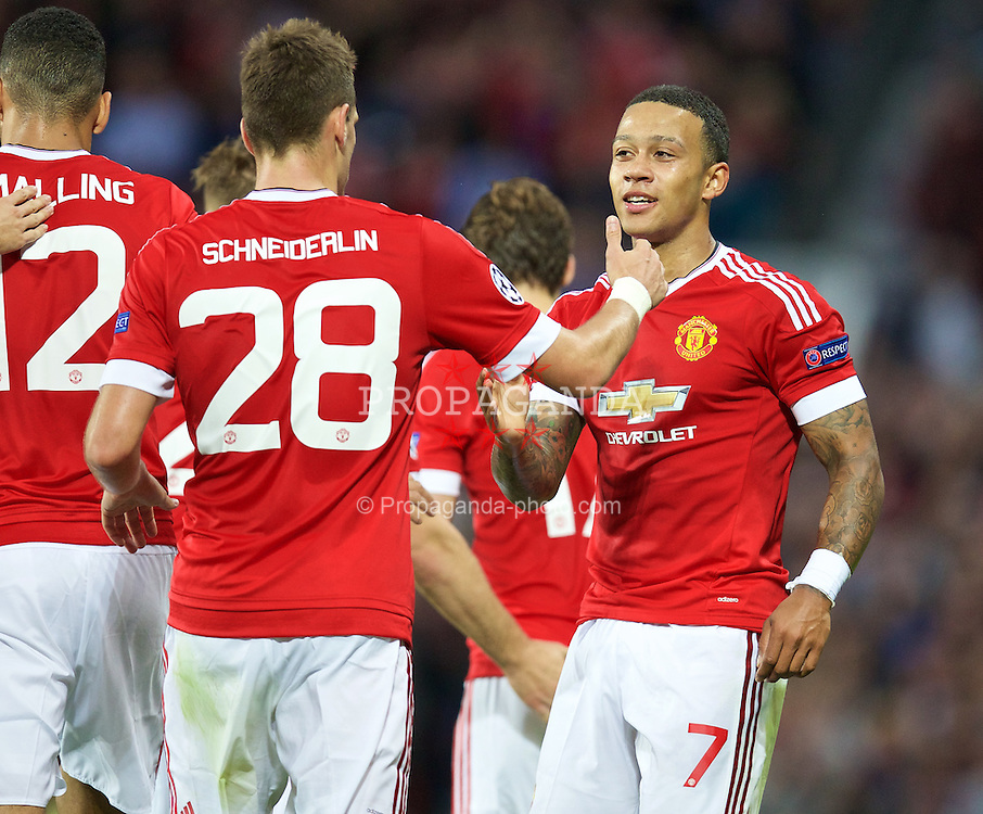 MANCHESTER, ENGLAND - Tuesday, August 18, 2015: Manchester United's Memphis Depay celebrates scoring the second goal against Club Brugge during the UEFA Champions League Play-Off Round 1st Leg match at Old Trafford. (Pic by David Rawcliffe/Propaganda)